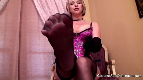 Foot goddess in pink corset and dark stockings