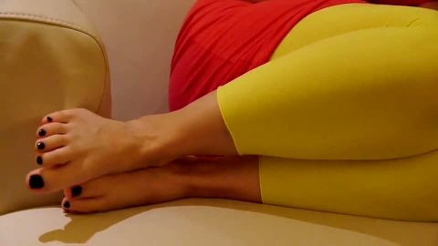 Tight yellow pants and sexy bare feet