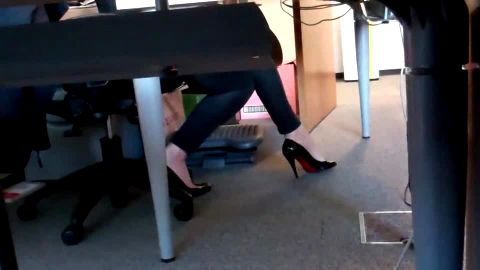 Hot secretary in tight jeans playing with her voyeur feet at the office
