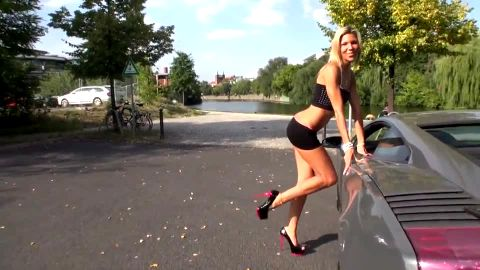 German Tamia poses on Lamborgini in sexy heels