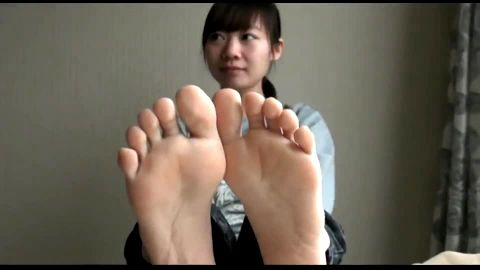 Cute Asian showing off sweet toes
