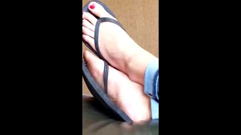 Girl wearing tight jeans and flip flops on her attractive voyeur feet with red nail polish