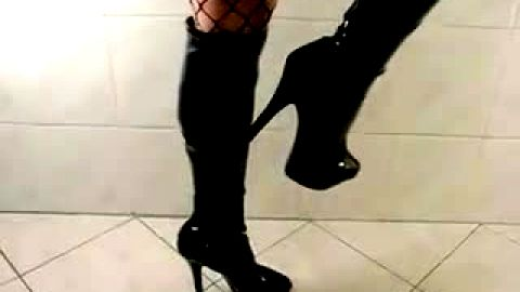 Leather stiletto boots and fishnet stockings