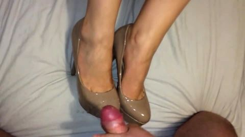 Cumming on tan patent leather pumps