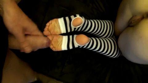 Amateur gets cum on her striped socks