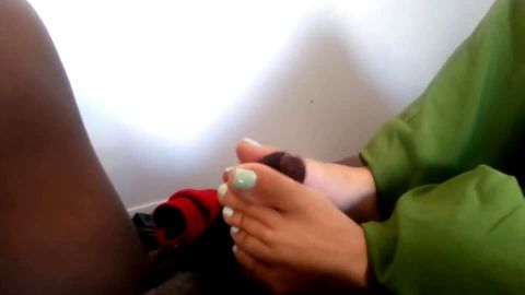 Interracial footjob from girl with bright painted toes