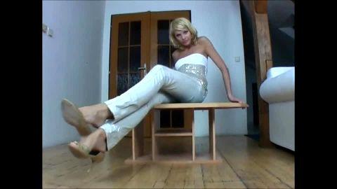 Shoe dangling long legged blonde