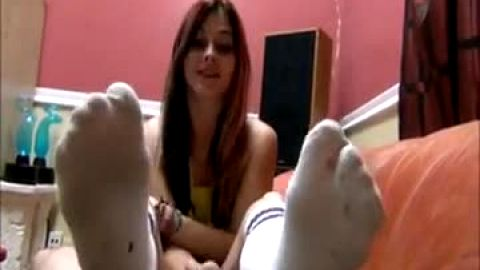 Giving fast footjob in cotton kneesocks