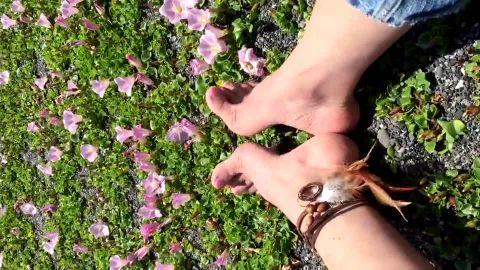 Rubbing feet together on beach