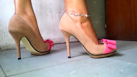 Tan pumps with pink bow ties