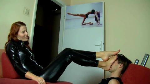 Leather foot goddess enjoys her footboy