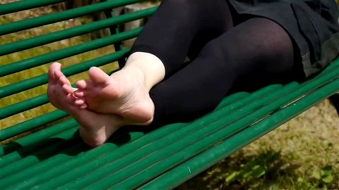 Toe stretching on green bench