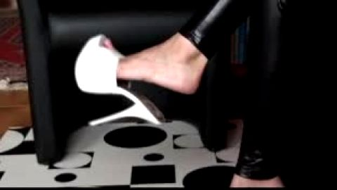 Open toed white leather stilettos