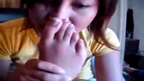 Holy shit, Batman! She's sniffing her own feet!
