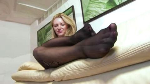 Foot teasing with black nylons