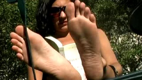 She doesn't know you're looking at her dirty feet