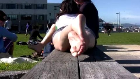 Bare feet getting sun In park