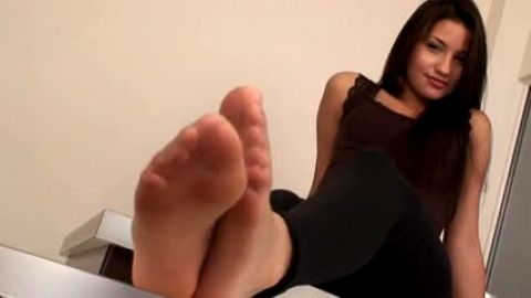 Dark haired foot tease in pantyhose