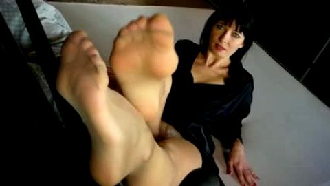 Feet in pantyhose closeup view for you