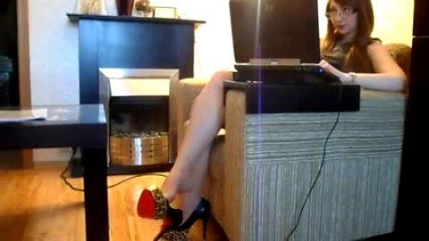 On laptop dangling leopard print pumps