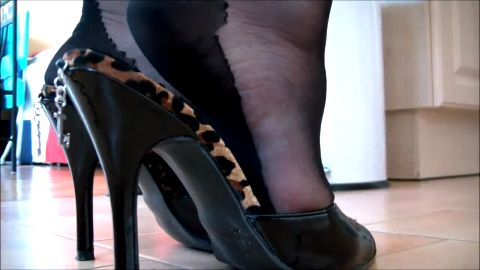Cuban heels and hot black sandals walking around house