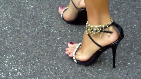 Candid walking in leather anklestraps