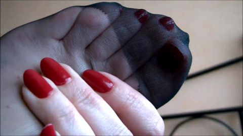 Feet in nylons closeup view