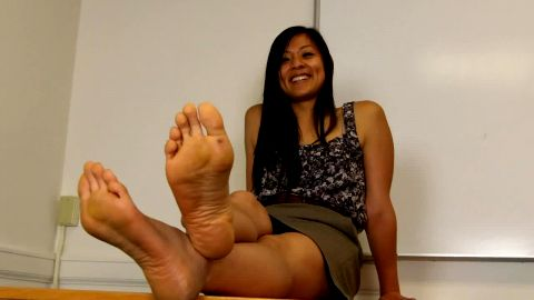 Black flats dropped from table uncovering calloused soles