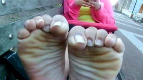 Bare feet on park bench