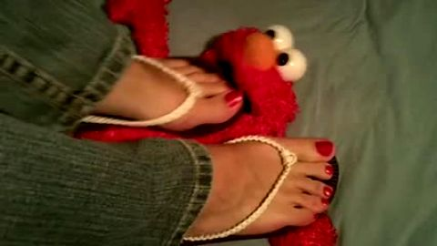 Flip flops crushing and trampling Elmo
