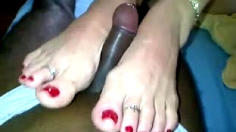 Amateur with toering gives Interracial footjob