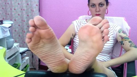 Amateur feet stretching out soles