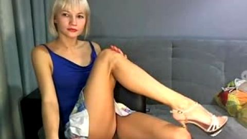 Showing strappy sandals over webcam