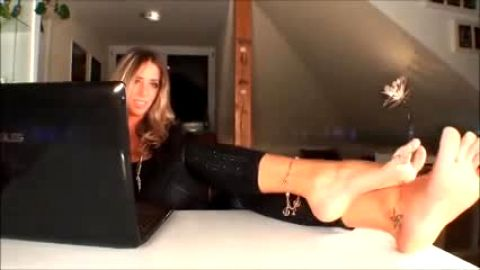 Foot amateur in glasses with long legs