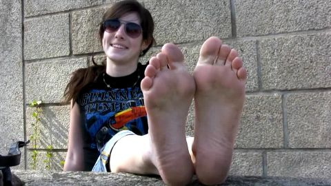 Hippie chick with dirty soles