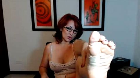 Mom working at home as a cam foot model