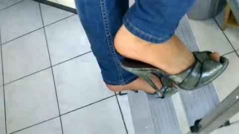 High heeled peeptoe mules on ladder • living dangerously