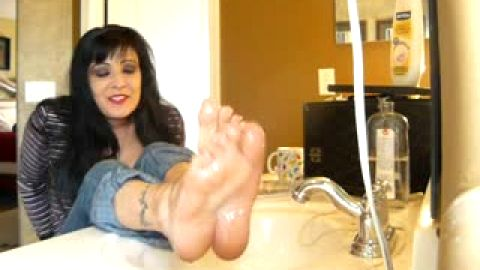Oiling up feet over sink