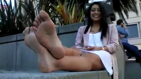 Super high arched Latina relaxing outdoors