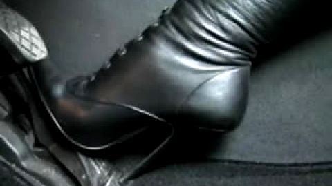 Black Stiletto Boots pumping gas pedal