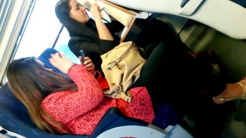 Amateurs in slingbacks pumping feet on train