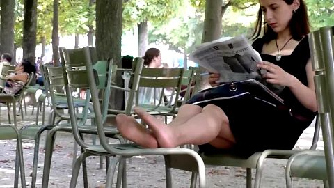Beautiful Woman Reading The Newspaper and Wearing Nylons Gets Her Feet Candidly Filmed