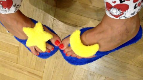 Girlie fuzzy moon flip flops and red toenails