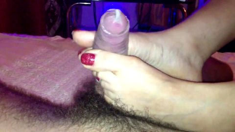 Amateur giving footjob to uncut schlong in condom