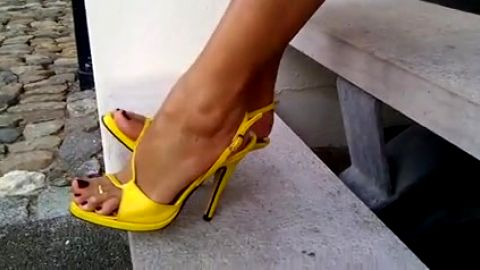 Yellow ankle straps on steps