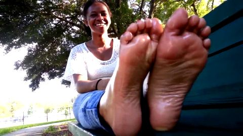Cute Black Girl Sits On Bench And Wiggles Around Her Little Black Feet