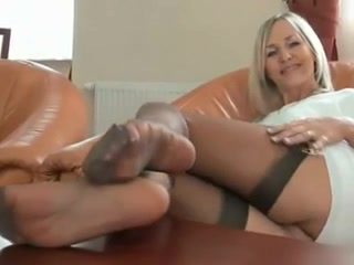Blonde womens feet and legs in sexy sheer pantyhose Hot Blonde In Tan Pantyhose Shows Her Legs