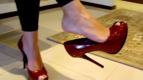 Dangling shiny deep red stiletto peeptoes