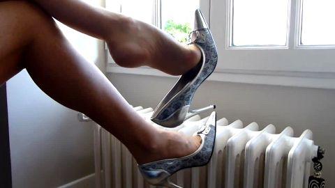Dangling metallic heels over radiator
