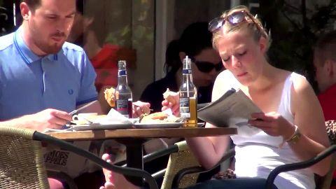 Cute Blonde Girl Secretly Gets Her Feet Filmed While Eating Lunch